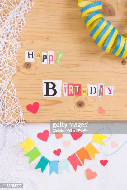 directly above shot of happy birthday decorations on table - birthday card stock pictures, royalty-free photos & images