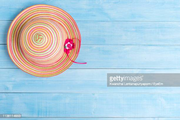 directly above shot of hat on table - blue hat stock pictures, royalty-free photos & images
