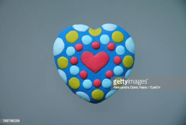 Directly Above Shot Of Heart Shape Candy On Gray Background