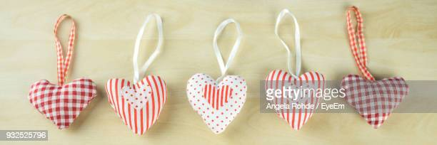 directly above shot of heart shape decorations on table - angela rohde stock-fotos und bilder