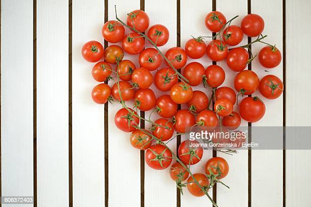 Directly Above Shot Of Heart Shape Made From Cherry Tomatoes