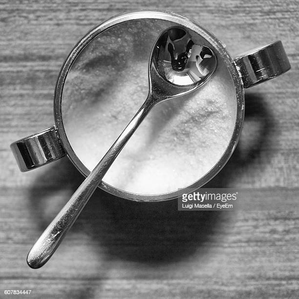 directly above shot of heart shape spoon in sugar bowl - sugar bowl crockery stock photos and pictures