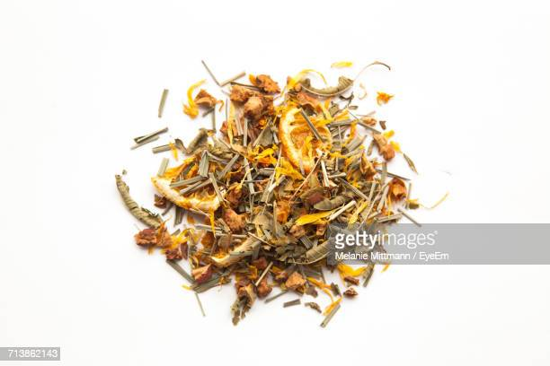 directly above shot of herbal tea ingredients over white background - tea leaves stock photos and pictures