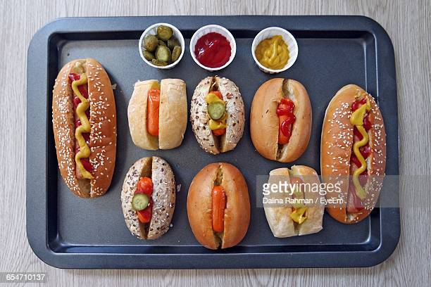 Directly Above Shot Of Homemade Hot Dogs In Serving Tray On Table