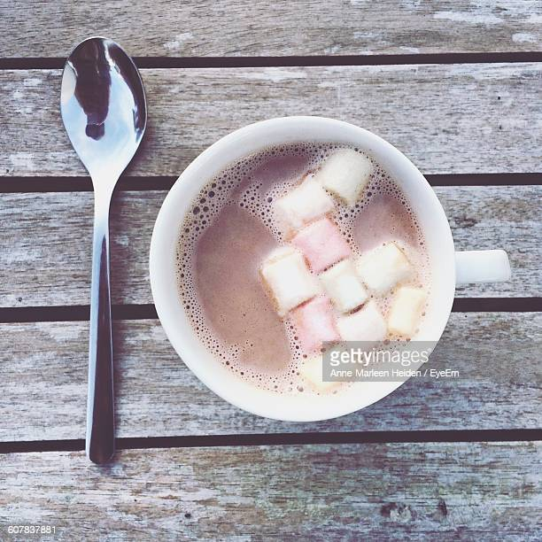 Directly Above Shot Of Hot Chocolate With Marshmallows In Cup On Table