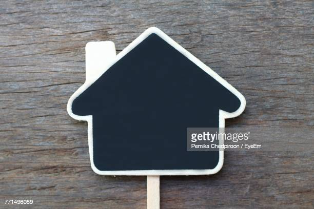 Directly Above Shot Of House Shaped Blank Sign On Table