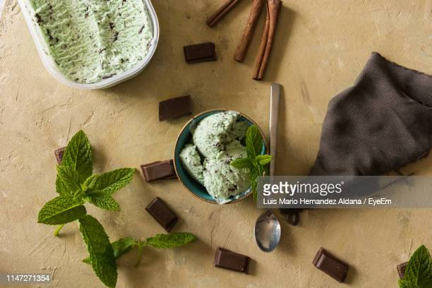 directly above shot of ice cream and chocolates on table - ミント ストックフォトと画像