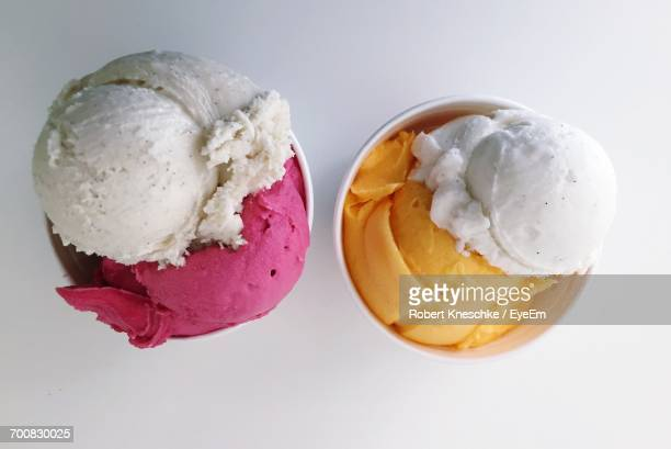 Directly Above Shot Of Ice Cream Cups On White Background
