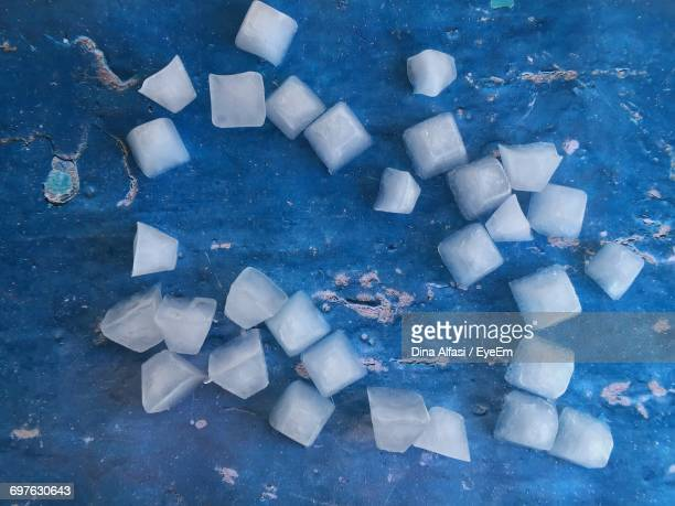 Directly Above Shot Of Ice Cubes On Blue Table