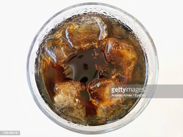 Directly Above Shot Of Ice Tea In Glass Over White Background