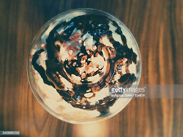 directly above shot of iced coffee on table - dessert topping stock pictures, royalty-free photos & images