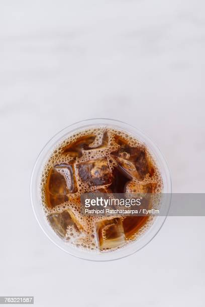 directly above shot of iced coffee over white background - iced coffee stock pictures, royalty-free photos & images