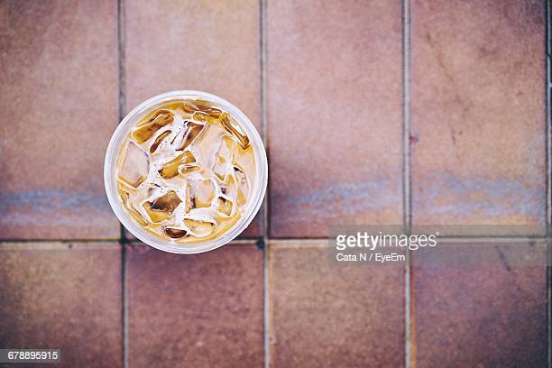 Directly Above Shot Of Iced Coffee Served On Table