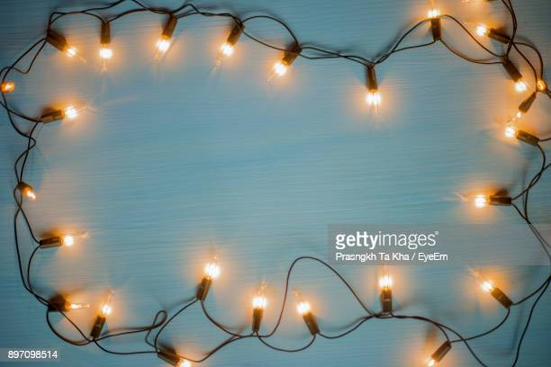 Directly Above Shot Of Illuminated String Lights On Table