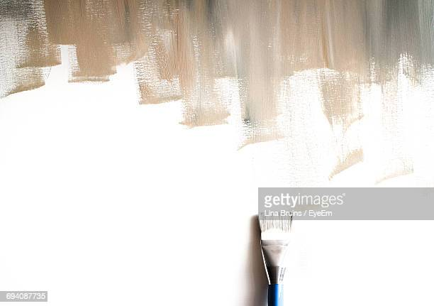 directly above shot of incomplete paint and brush on white background - incomplete stock pictures, royalty-free photos & images