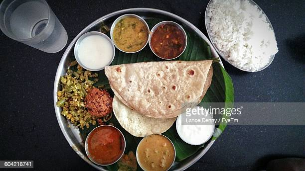 directly above shot of indian food served on table - indian food stock photos and pictures