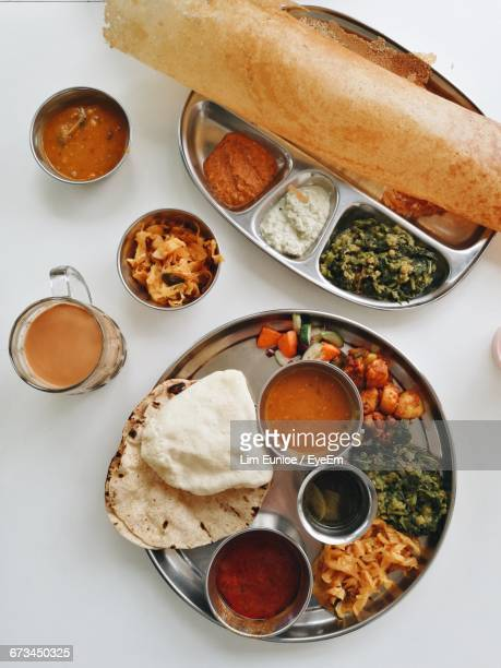 directly above shot of indian food served on table - dosa stock photos and pictures