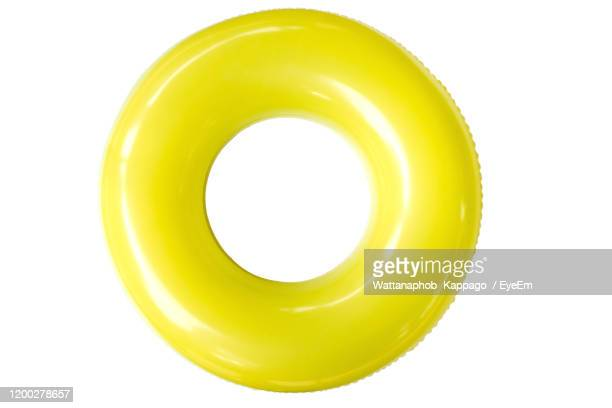 directly above shot of inflatable ring over white background - inflatable stock pictures, royalty-free photos & images