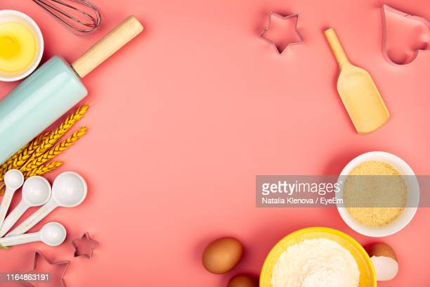 directly above shot of ingredient and kitchen utensil on colored background - cooking utensil stock pictures, royalty-free photos & images