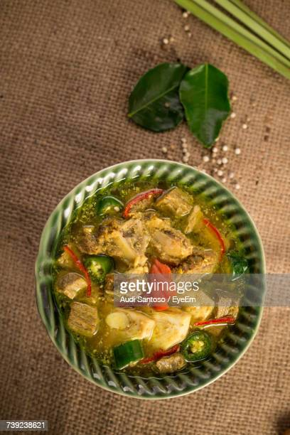 directly above shot of jackfruit curry in bowl on table - jackfruit stock photos and pictures