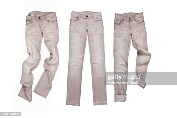 directly above shot of jeans over white background - pantalon photos et images de collection