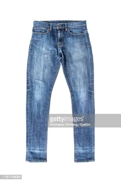 directly above shot of jeans pant over white background - trousers stock pictures, royalty-free photos & images