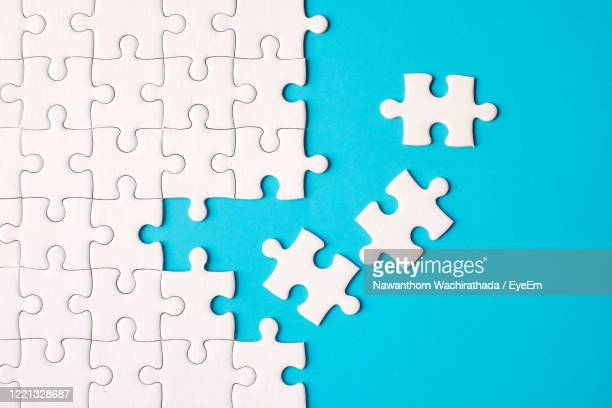 directly above shot of jigsaw puzzle on blue background - 電動糸のこ ストックフォトと画像