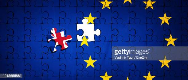 directly above shot of jigsaw puzzle with flags - brexit stock pictures, royalty-free photos & images