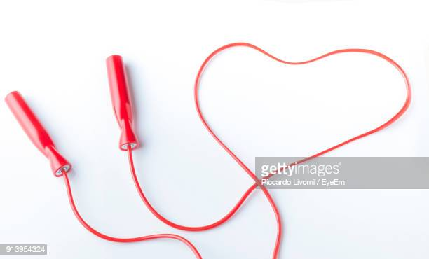 directly above shot of jump rope over white background - skipping rope stock pictures, royalty-free photos & images