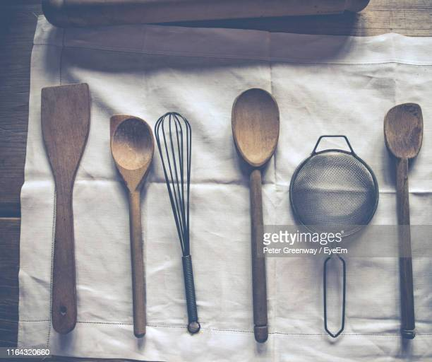 directly above shot of kitchen objects on fabric - bicester village stock pictures, royalty-free photos & images