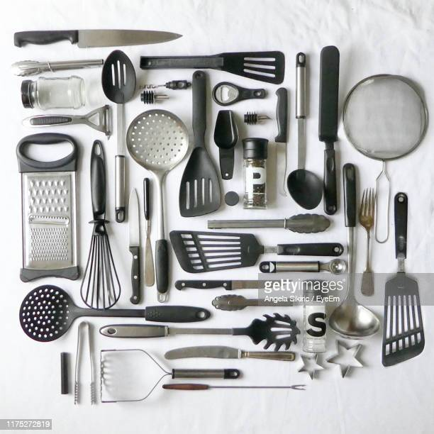 directly above shot of kitchen utensils on table - cooking utensil stock pictures, royalty-free photos & images