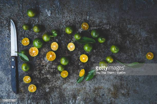 Directly Above Shot Of Kumquats With Knife On Kitchen Counter