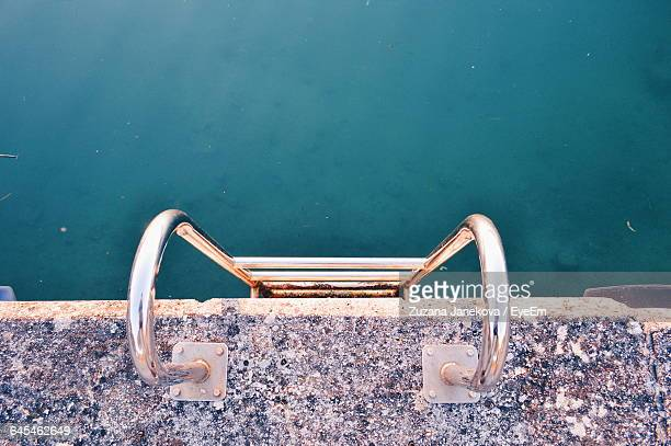 directly above shot of ladder attached to pier over sea - zuzana janekova stock pictures, royalty-free photos & images