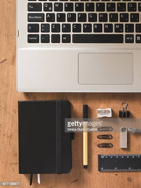 Directly Above Shot Of Laptop By Office Supply On Table