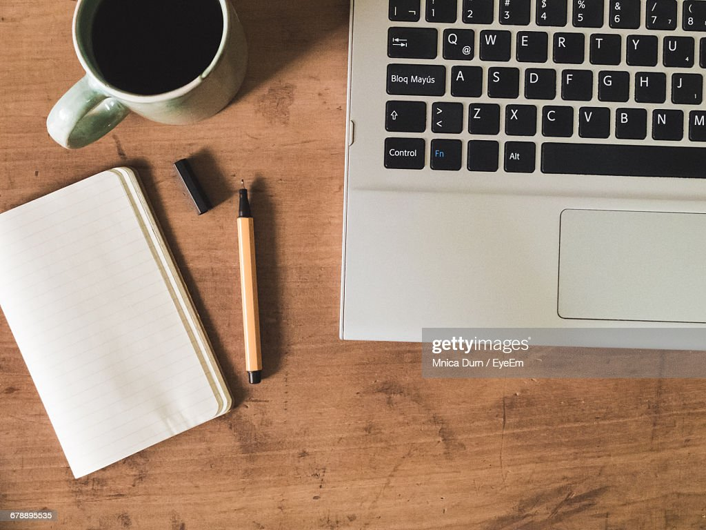 Directly above shot of laptop with coffee cup and book on wooden directly above shot of laptop with coffee cup and book on wooden table geotapseo Gallery