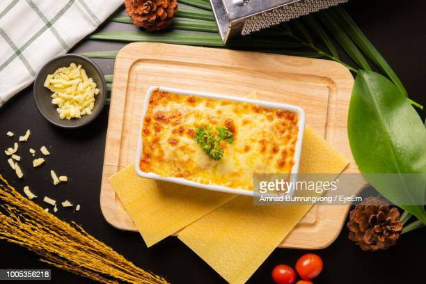 directly above shot of lasagne in container on cutting board - lasagna stock pictures, royalty-free photos & images