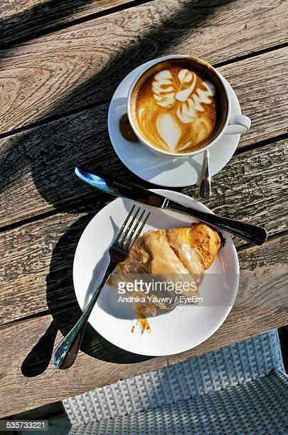 Directly Above Shot Of Latte And Caramel Croissant Served On Table
