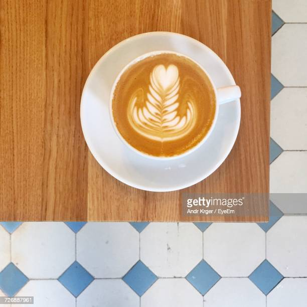 Directly Above Shot Of Latte Served On Wooden Table At Restaurant