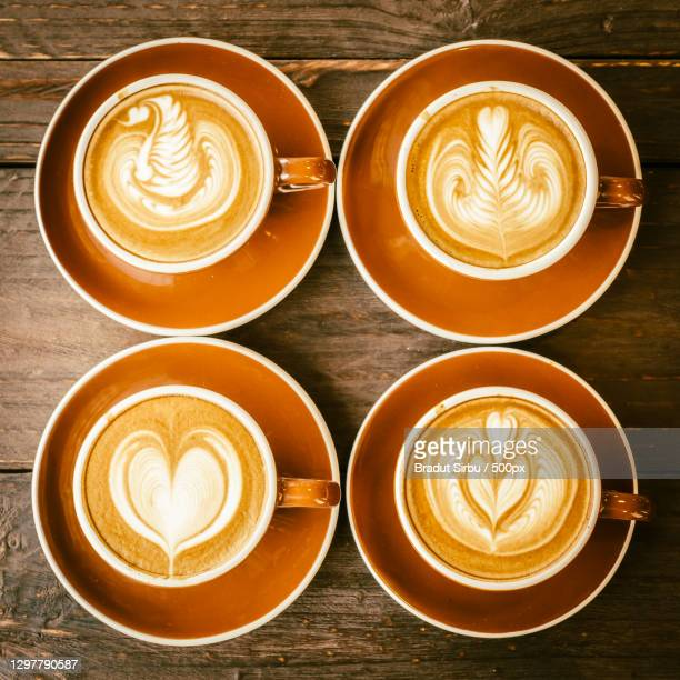 directly above shot of lattes with various froth art - images stock pictures, royalty-free photos & images