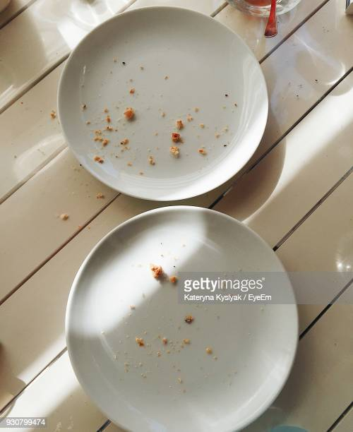Directly Above Shot Of Leftovers In Plates On Table