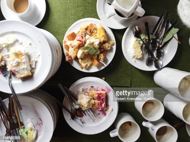 directly above shot of leftovers on table - leftovers stock pictures, royalty-free photos & images
