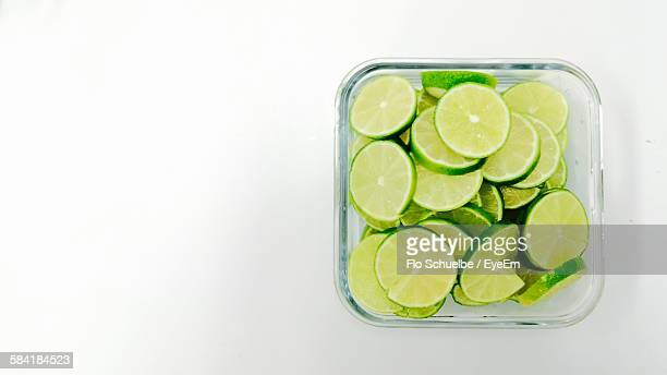 Directly Above Shot Of Lemon Slices In Tray Against White Background