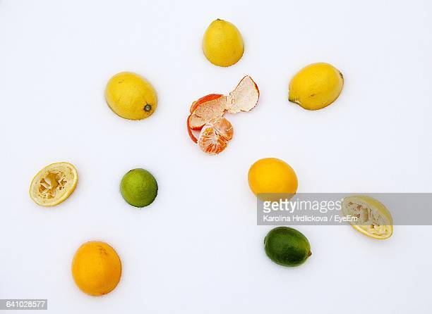 Directly Above Shot Of Lemons And Orange On Snow Covered Field