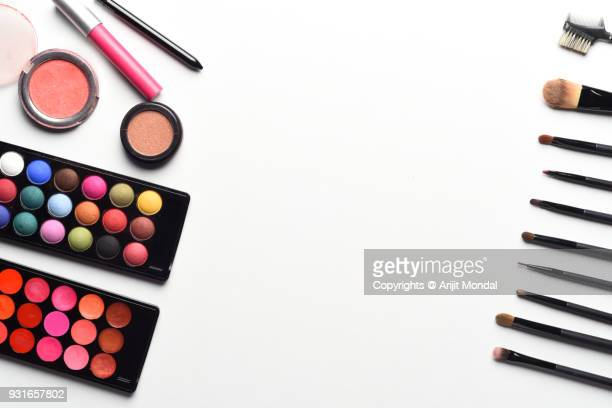 Directly above shot of Make-up products, make-up cosmetics, makeup brushes on white background, flat lay copy area