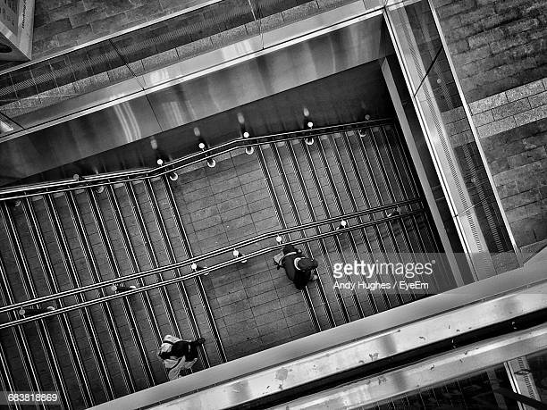 Directly Above Shot Of Man And Woman Walking On Steps