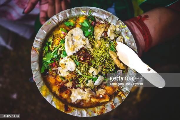 directly above shot of man holding food in plate - kolkata stock pictures, royalty-free photos & images