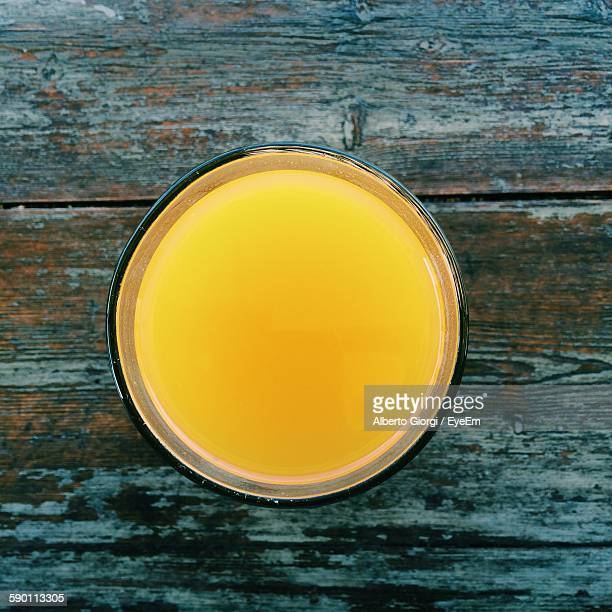 Directly Above Shot Of Mango Juice Glass On Wooden Table