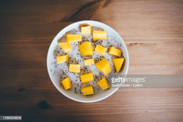 directly above shot of mango slices with chia seats in bowl on table - mousse dessert stock pictures, royalty-free photos & images