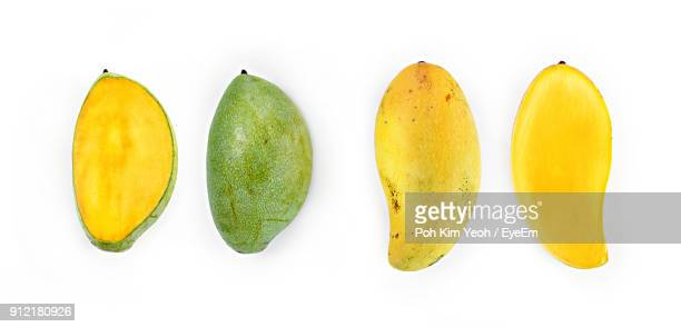 Directly Above Shot Of Mangoes Over White Background