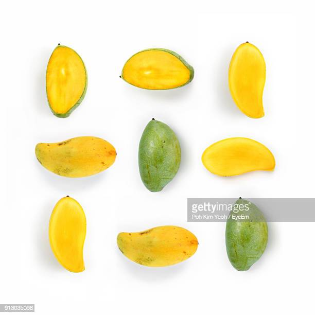 directly above shot of mangoes over white background - mango fotografías e imágenes de stock
